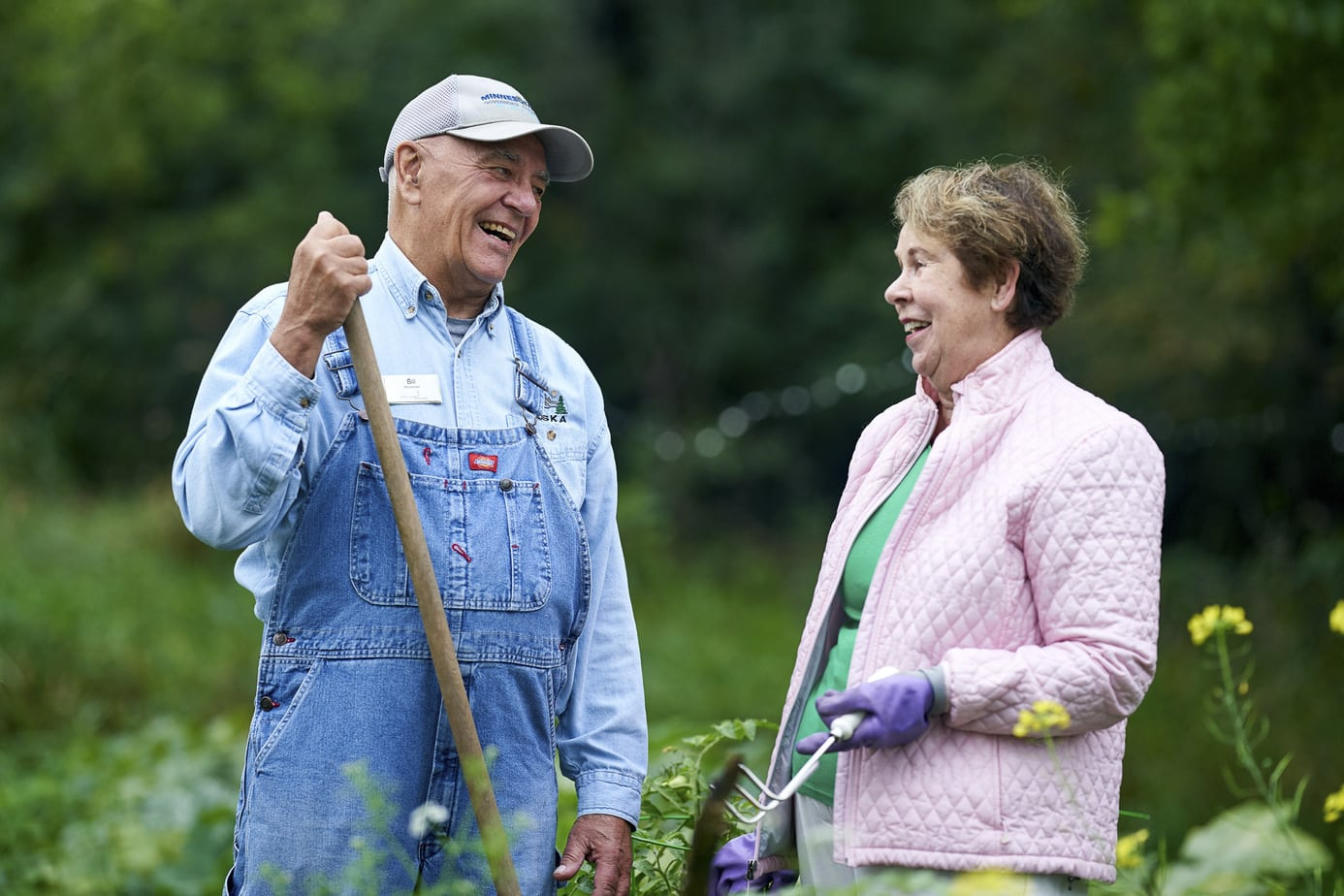 Retirement community photography. Active seniors gardening.