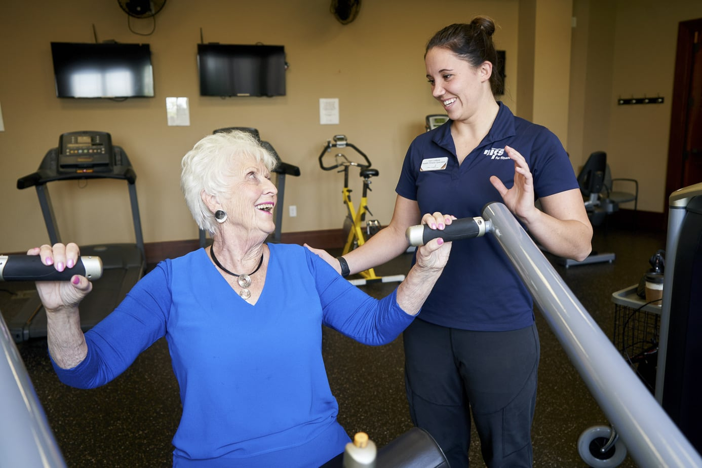 Retirement community photography. Active seniors exercising with staff member