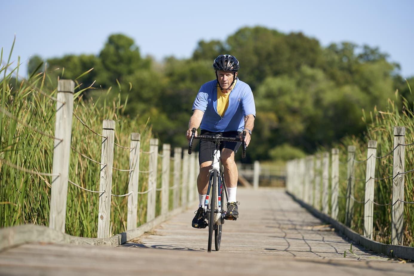 Retirement community photography. Active seniors, man riding bike