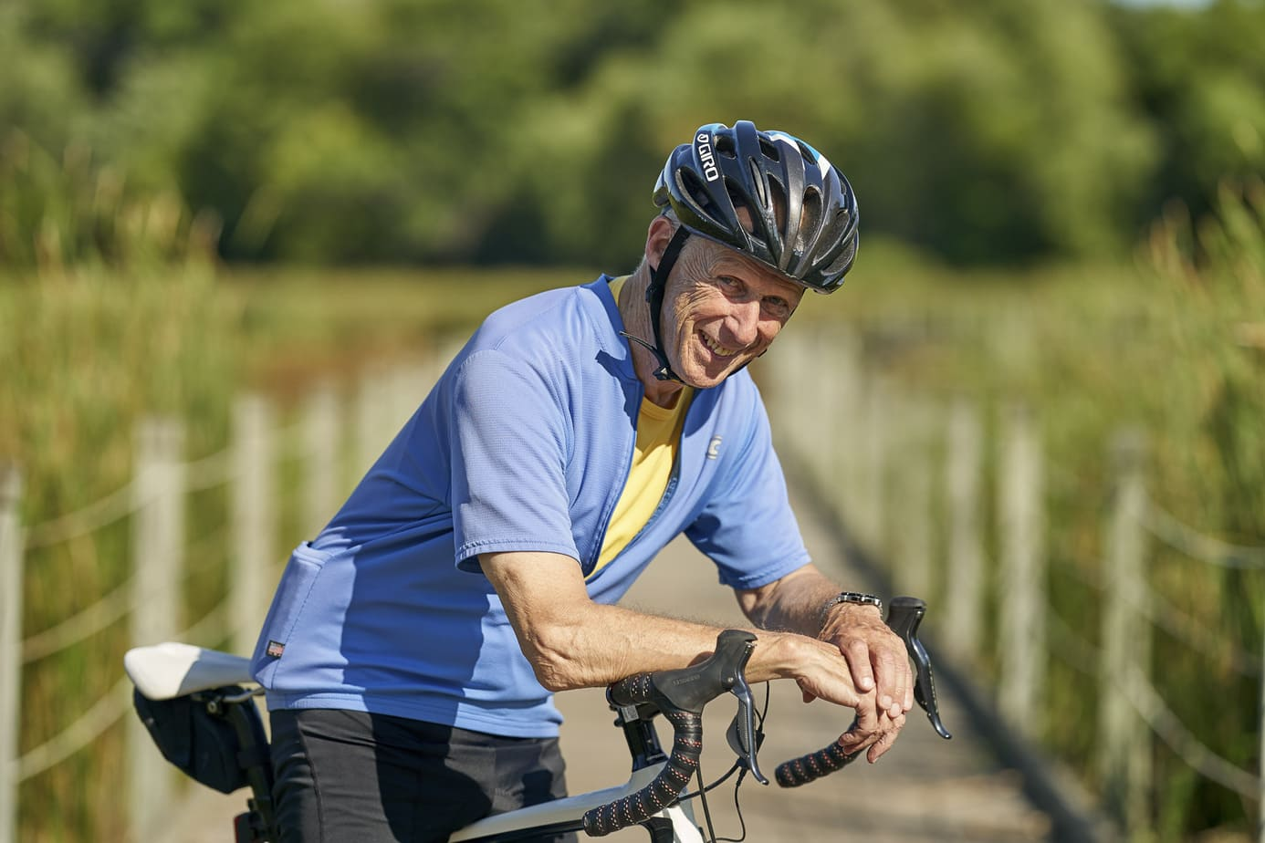 Retirement community photography. Active seniors, man riding bike
