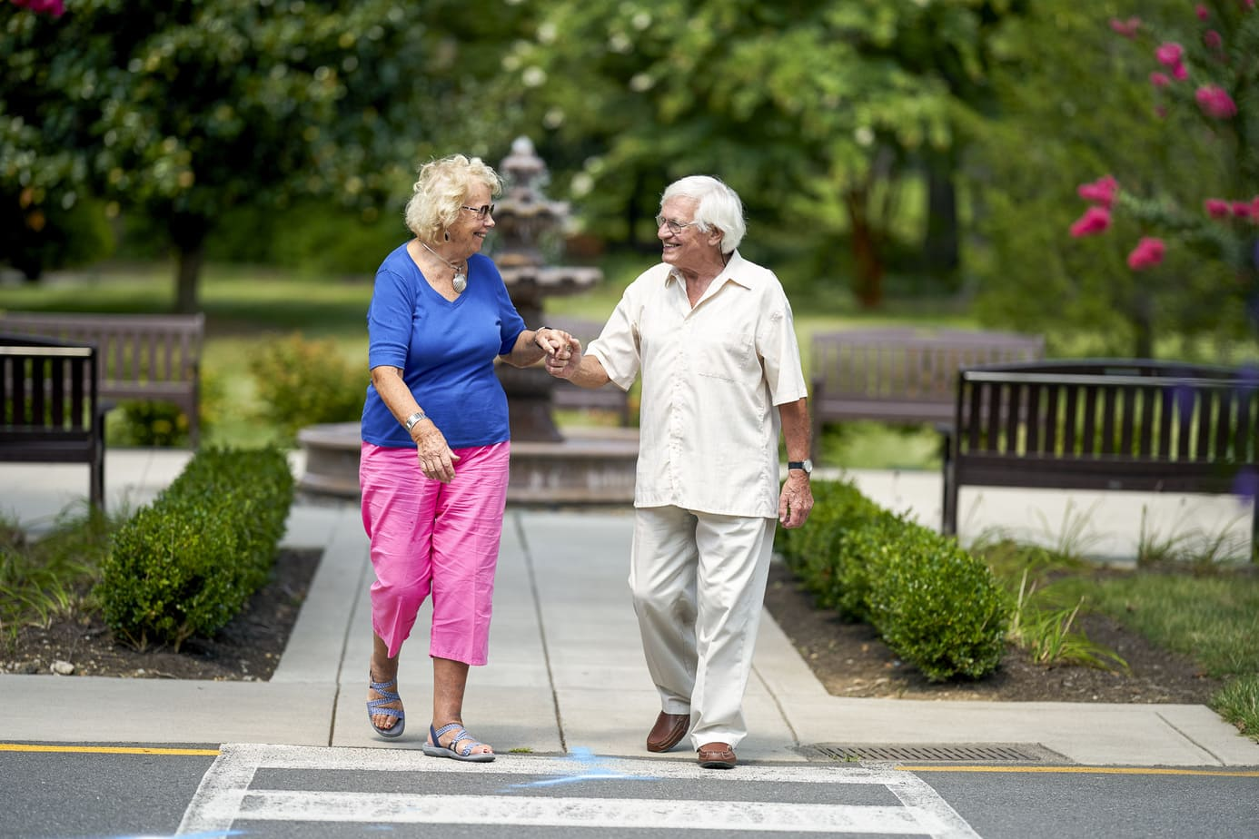 Senior Living Retirement community photography. Resident couple walking together, happy
