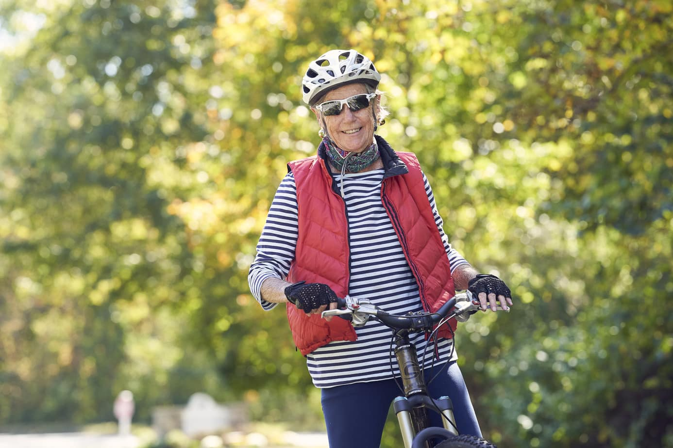 Senior Living Retirement community photography. Active senior riding bike exercising