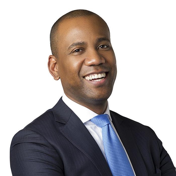 Professional headshots African american man suit blue tie